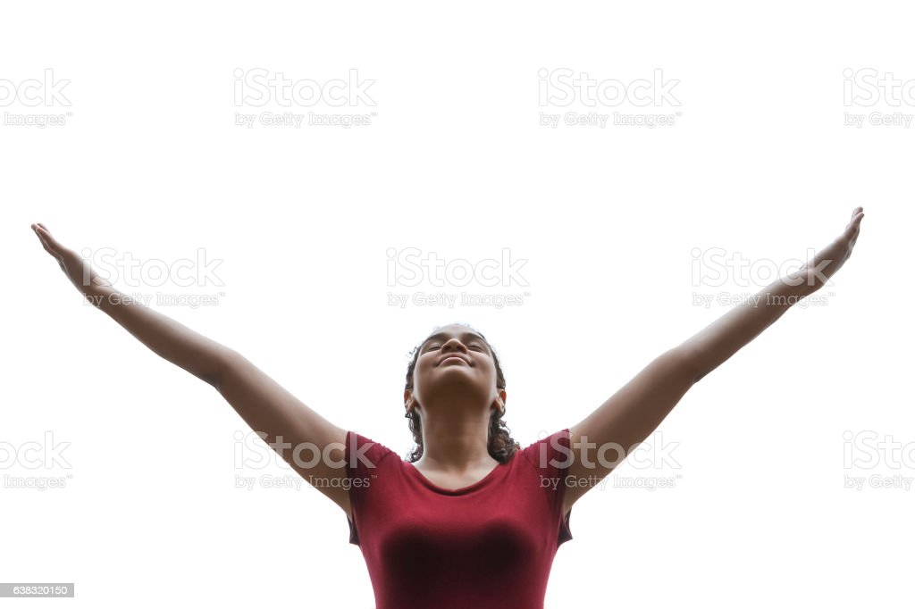 Woman praising and worshiping with arms raised stock photo