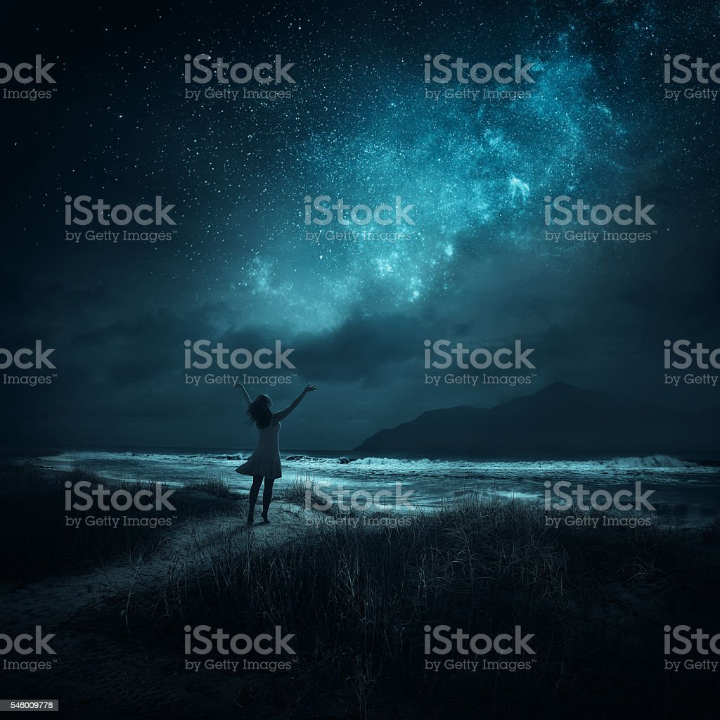 Woman praising at night stock photo