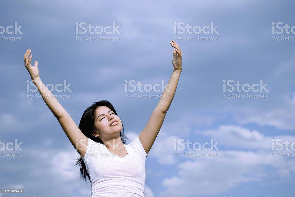 Woman praising God stock photo