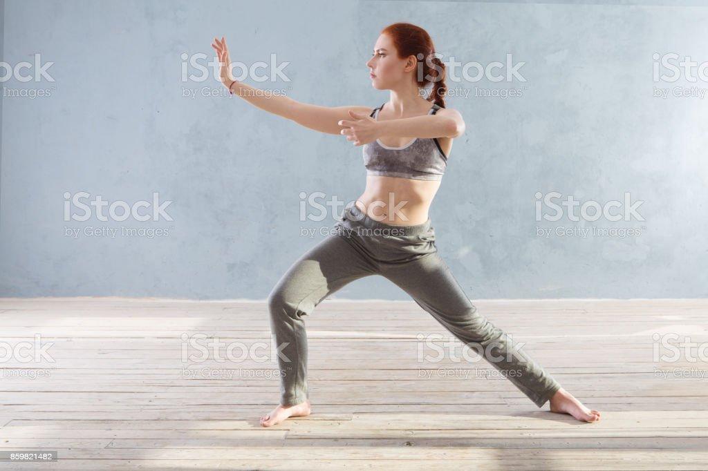 Woman praticing tai chi chuan in the gym. stock photo