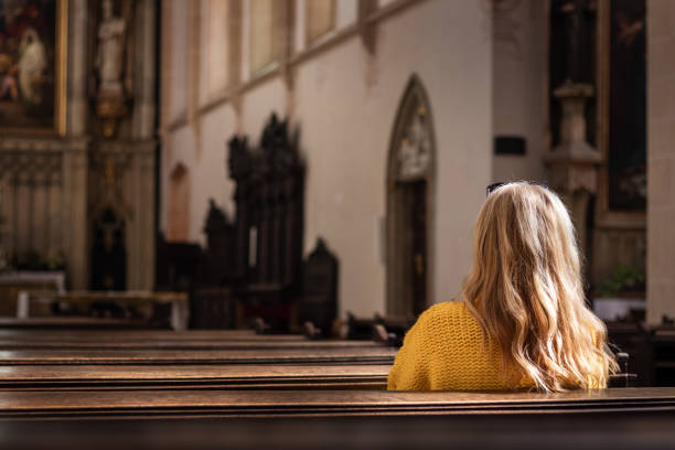 Woman pray in church. Believe in god stock photo