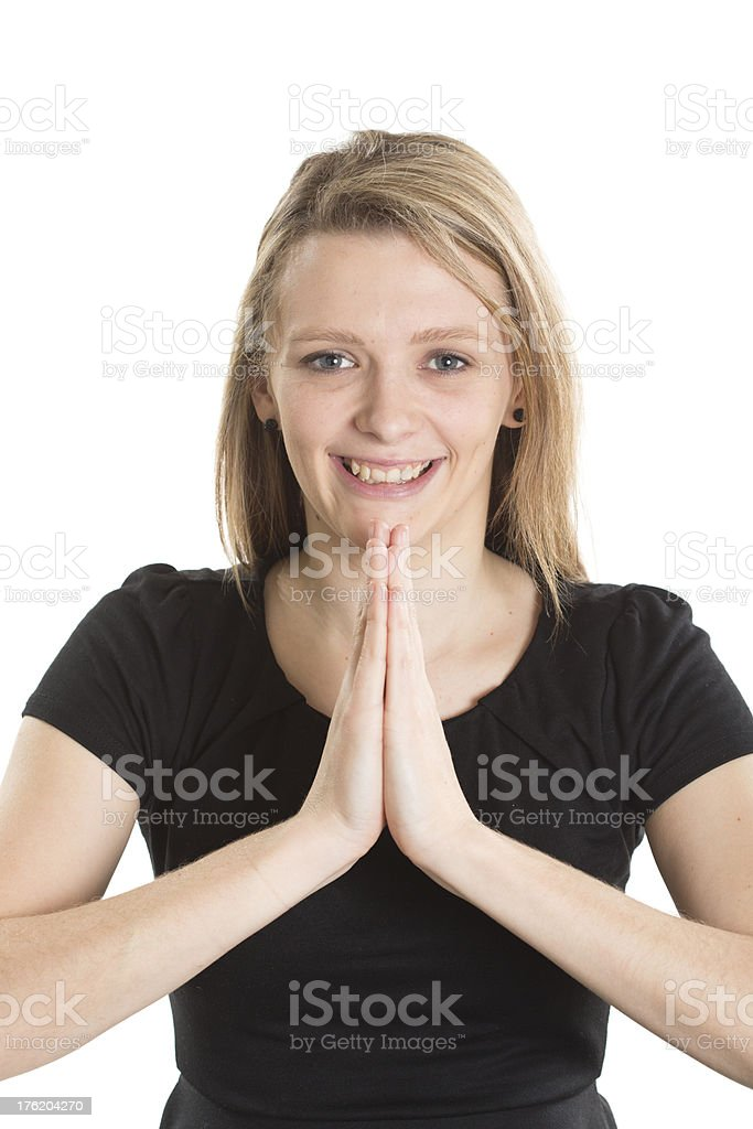 Woman Praying and Smiling royalty-free stock photo