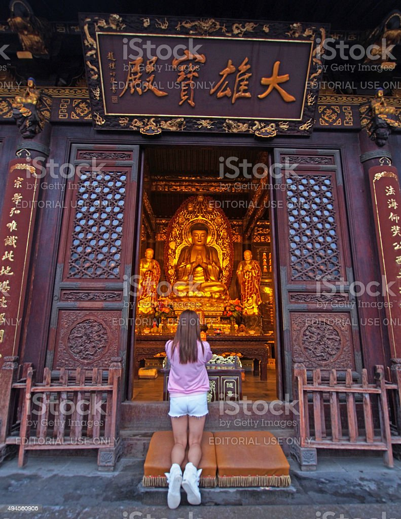 Woman Praying at Giant Wild Goose Pagoda in Xian China stock photo