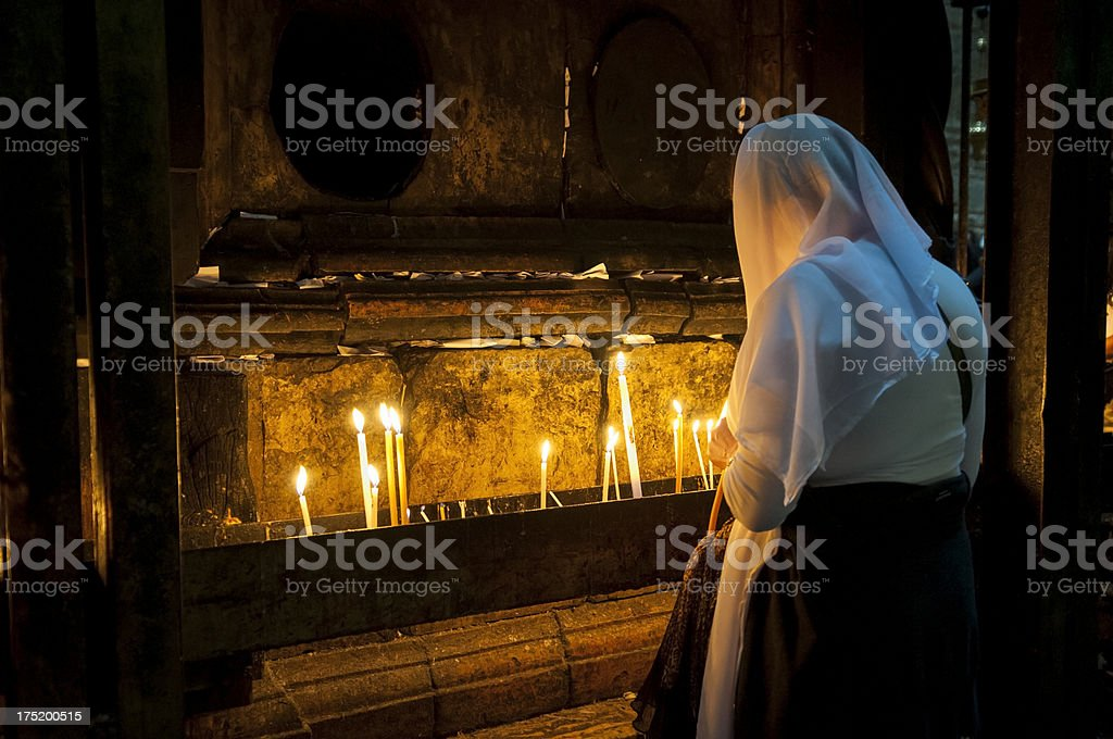 Woman praying in Jerusalem stock photo