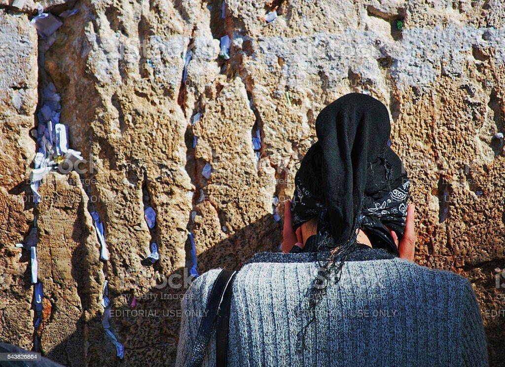 Woman praying at Wailing Wall, Jerusalem, Israel stock photo