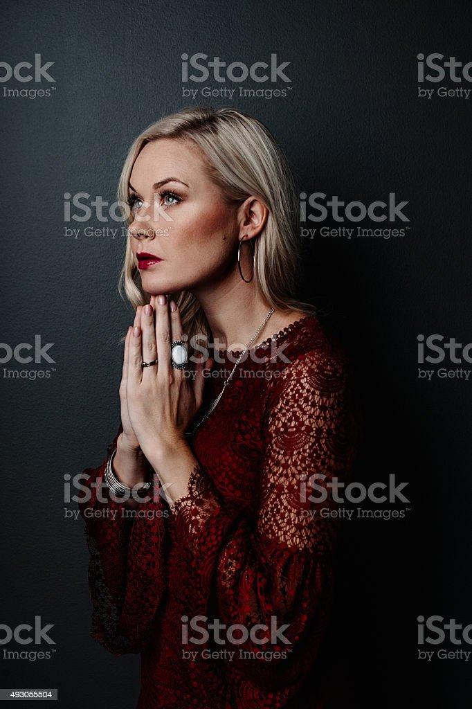 Woman praying hands in namaste stock photo