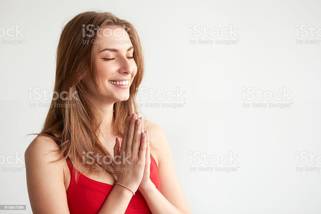 Woman praying hands together, namaste, yoga. stock photo