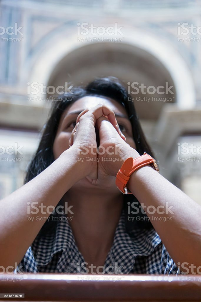 Woman praying in church stock photo