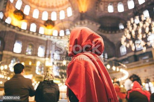 istock Woman Praying Inside A Mosque 503051410
