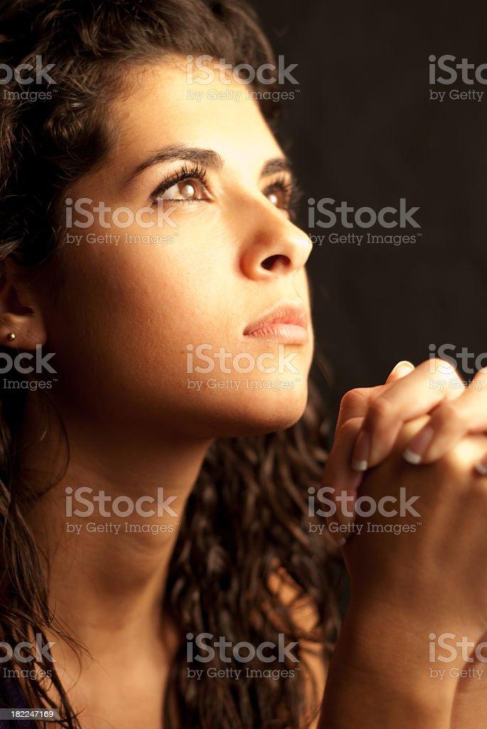 Woman Praying - Looking up royalty-free stock photo