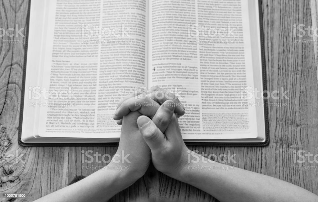 Woman Praying On Bible Book Stock Photo - Download Image Now
