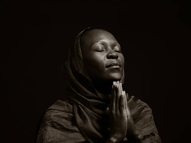 royalty free black woman praying pictures images and stock photos