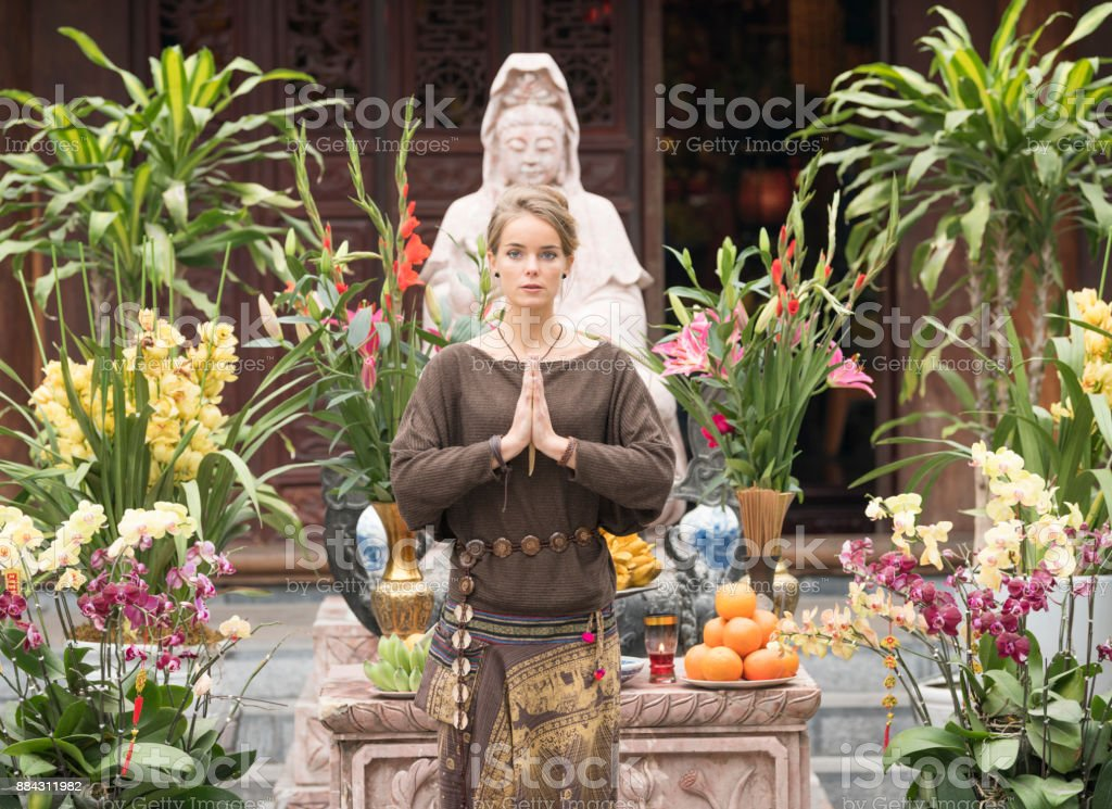 Woman praying, Religious Offering stock photo