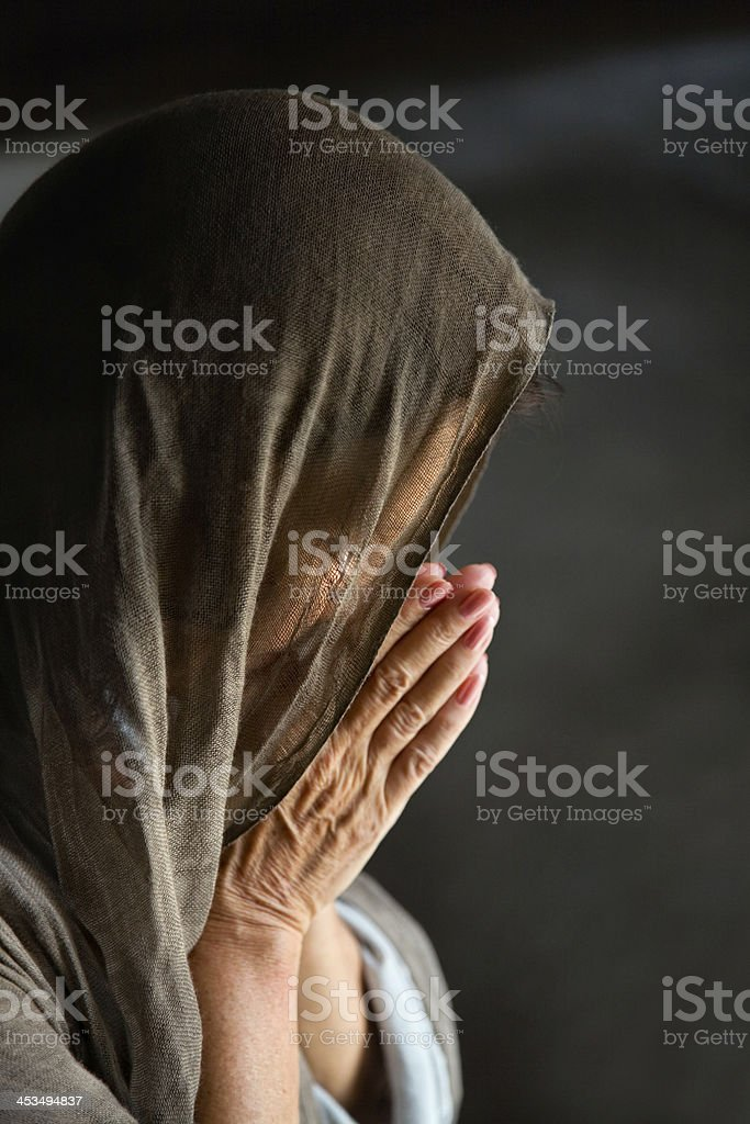 Woman praying with hands royalty-free stock photo
