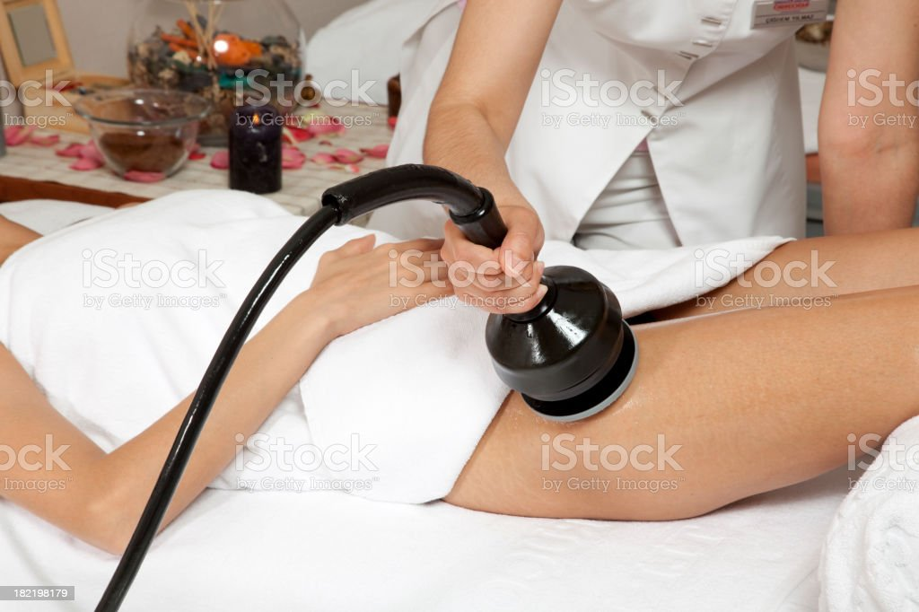 A woman preforming a spa treatment on a client stock photo