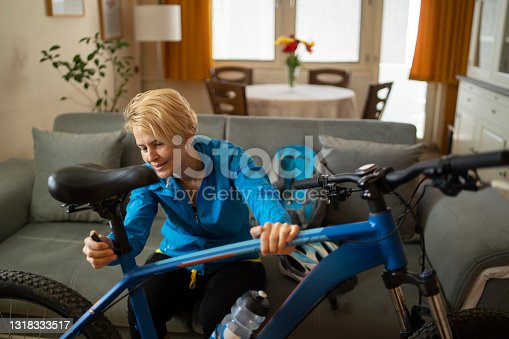 istock A woman prepares her bicycle ready for a bikeride 1318333517