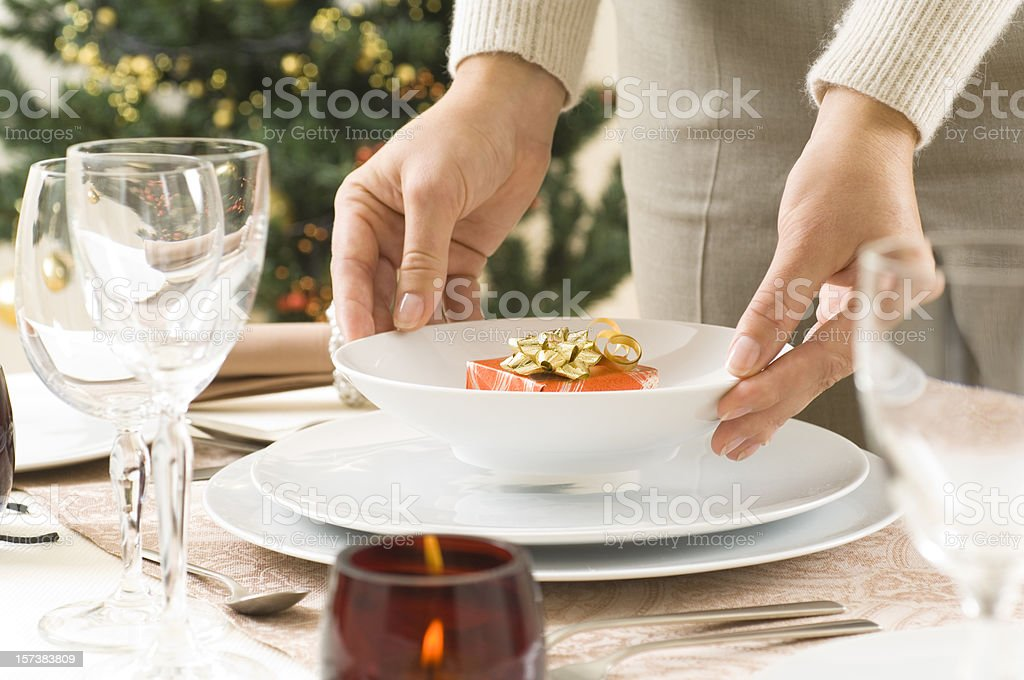 Woman preparing a diner table royalty-free stock photo