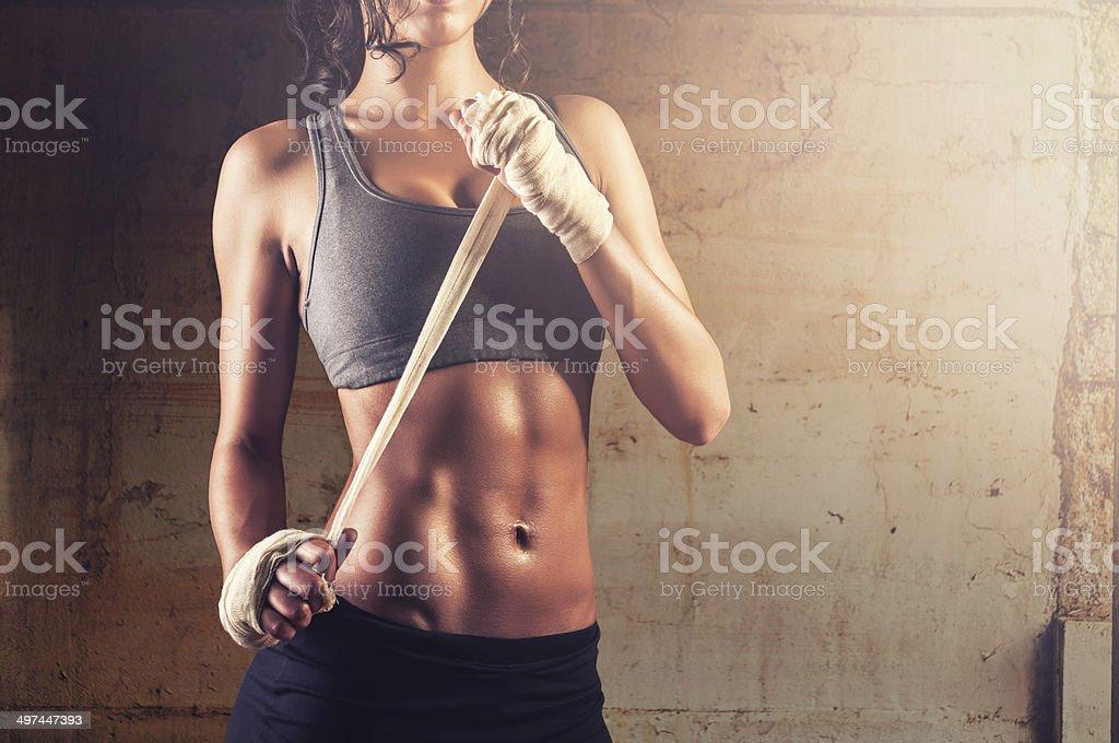 Woman preparing bandages for training stock photo
