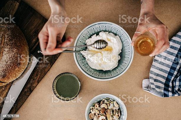 Woman preparing breakfast yogurt and honey picture id487978738?b=1&k=6&m=487978738&s=612x612&h=buxdunkaautbenuesbivedsustbj8gjxomv9qdybuww=