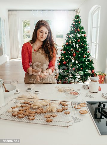 istock Woman preparing cookies for Christmas. 865857584