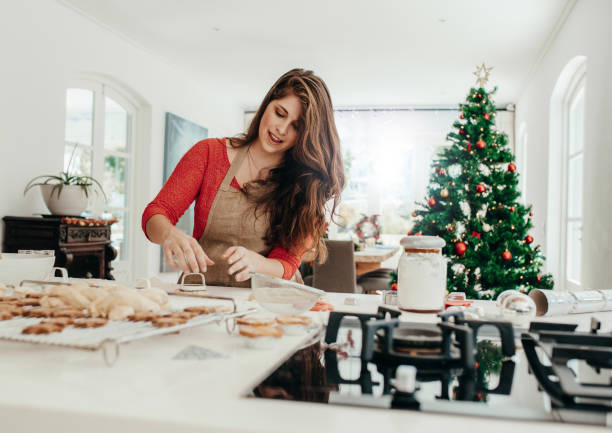 woman preparing cookies for christmas. - christmas cooking foto e immagini stock