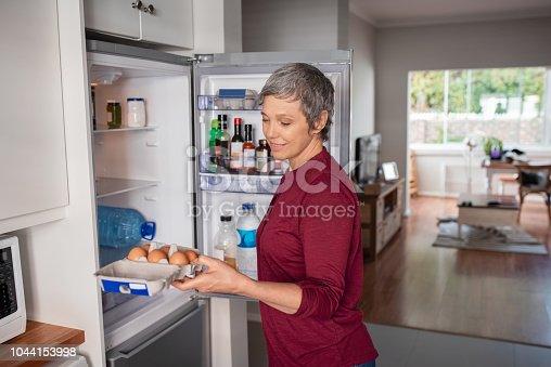 istock Woman preparing dinner 1044153998