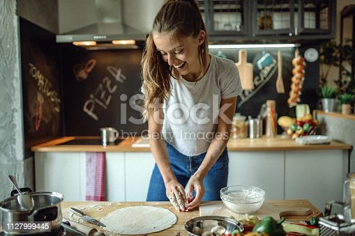 istock Woman preparing dought for pizza 1127999445