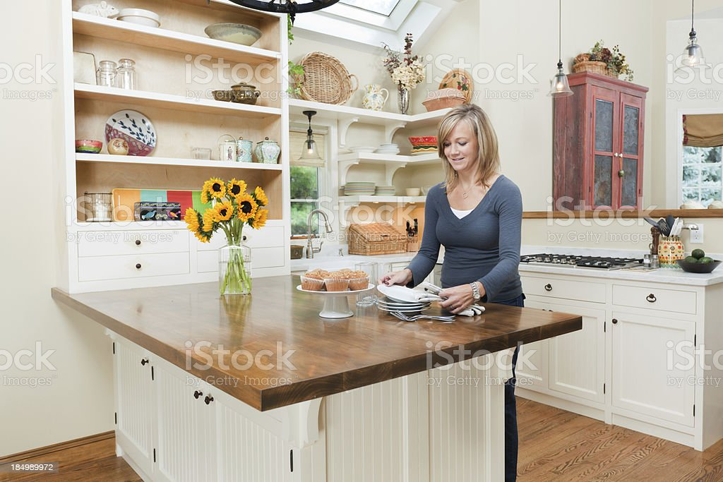 Woman Preparing Food in Contemporary Residential Home Kitchen Hz stock photo