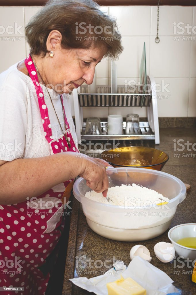 Woman preparing food in the kitchen. royalty-free stock photo
