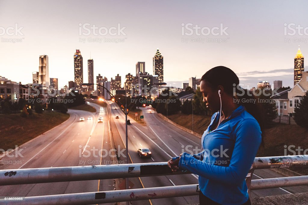 woman preparing for a run in the city stock photo