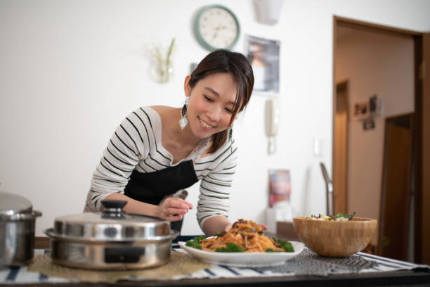 Woman preparing for meal at home Woman preparing for meal at home homemaker stock pictures, royalty-free photos & images