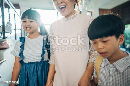 istock Woman preparing kids for school 1179023916