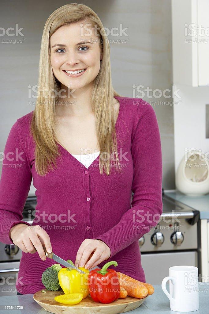 Woman preparing meal royalty-free stock photo