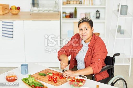 594475880istockphoto Woman preparing salad 1178265025