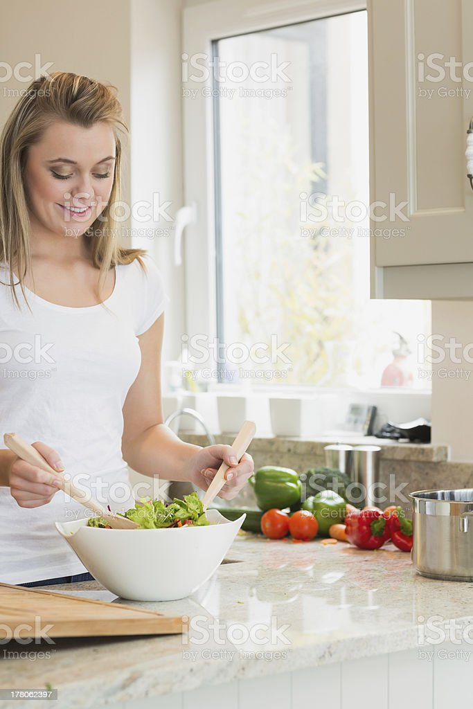 Woman preparing salad royalty-free stock photo