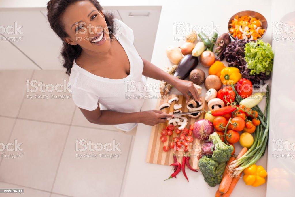 Woman preparing salad. stock photo