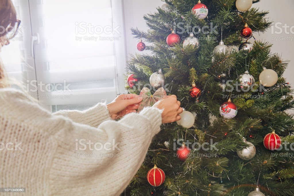 Woman preparing shiny decoration for Christmas / New Year's eve. stock photo