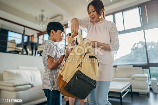 istock Woman preparing son for school 1151176639