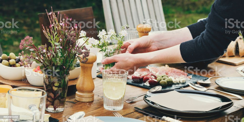 Woman Preparing Table Dinner Concept stock photo