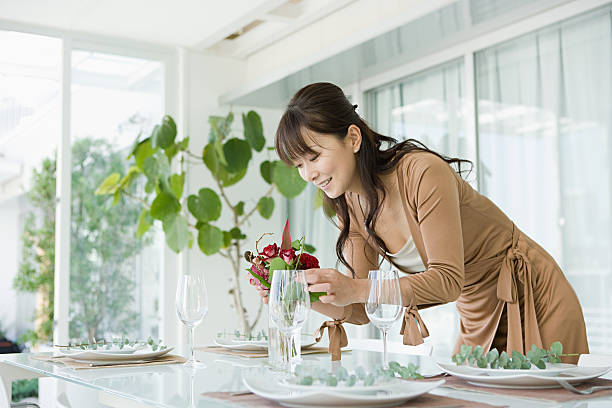 Woman preparing table picture id80992283?b=1&k=6&m=80992283&s=612x612&w=0&h=uw3xkkkt73ajj96jntysqowwu69ibs16ikywbanlejk=