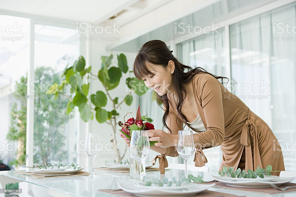 Woman preparing table stock photo