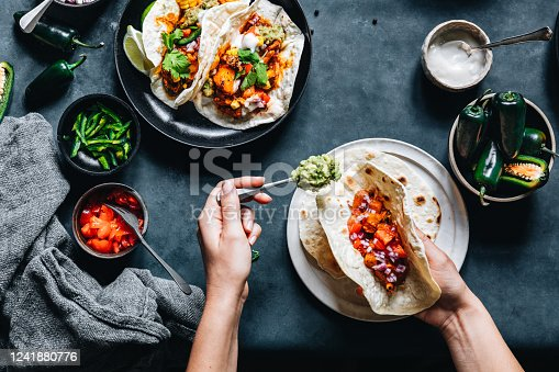 istock Woman preparing tasty vegan tacos 1241880776