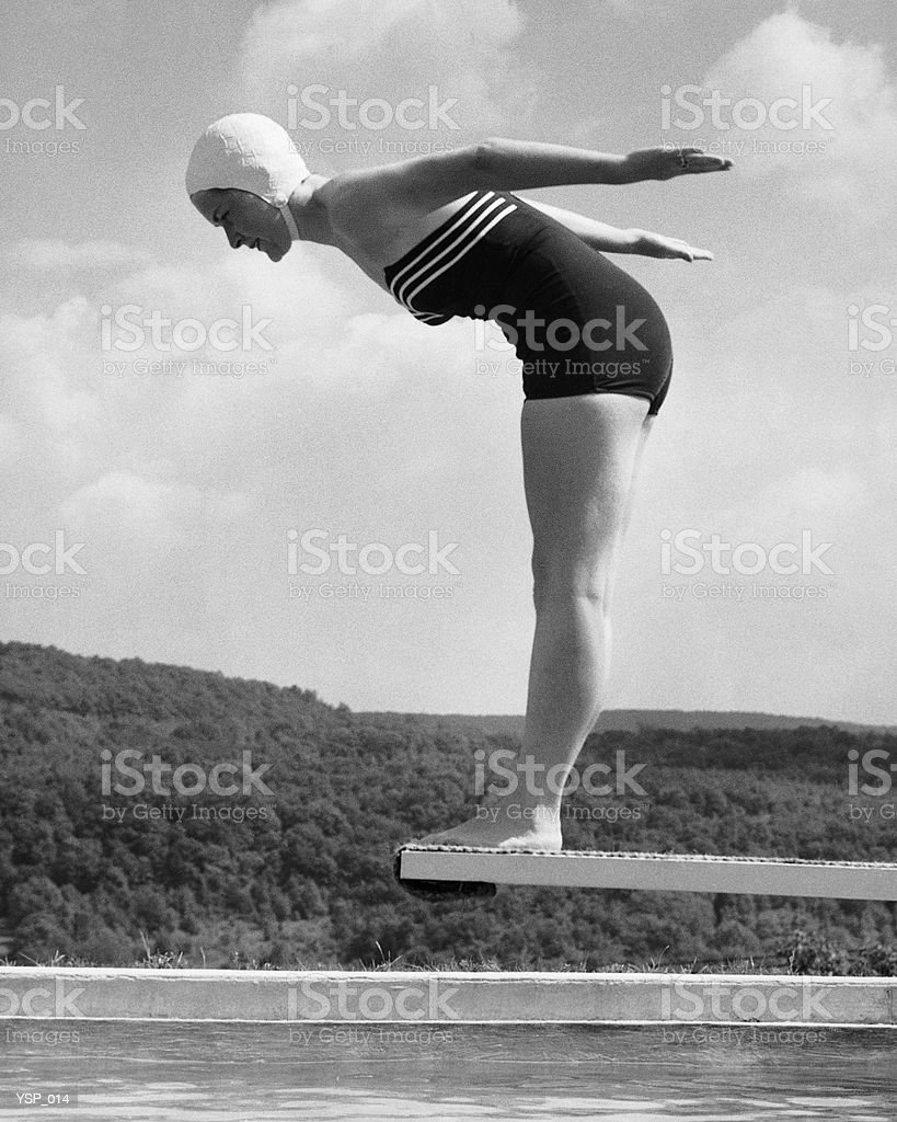 Woman preparing to dive into pool royalty free stockfoto