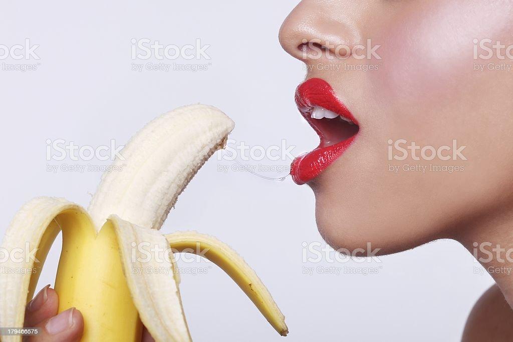 Woman Preparing to Eat a Banana stock photo