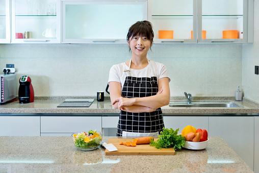Woman preparing to make vegetable salads