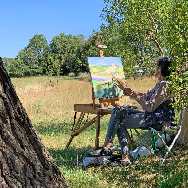 Woman preparing to paint en plein air stock photo