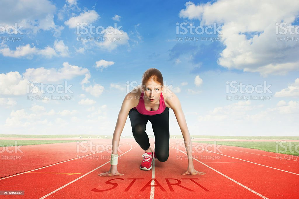 Woman preparing to run stock photo
