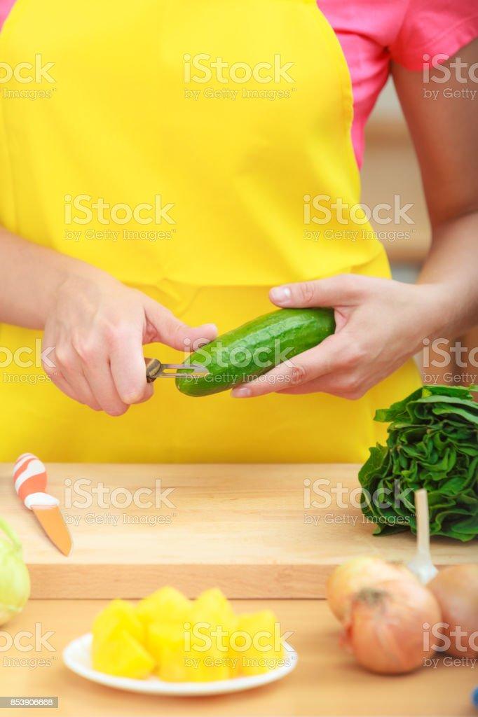 Woman Preparing Vegetables Salad Peeling Cucumber Stock