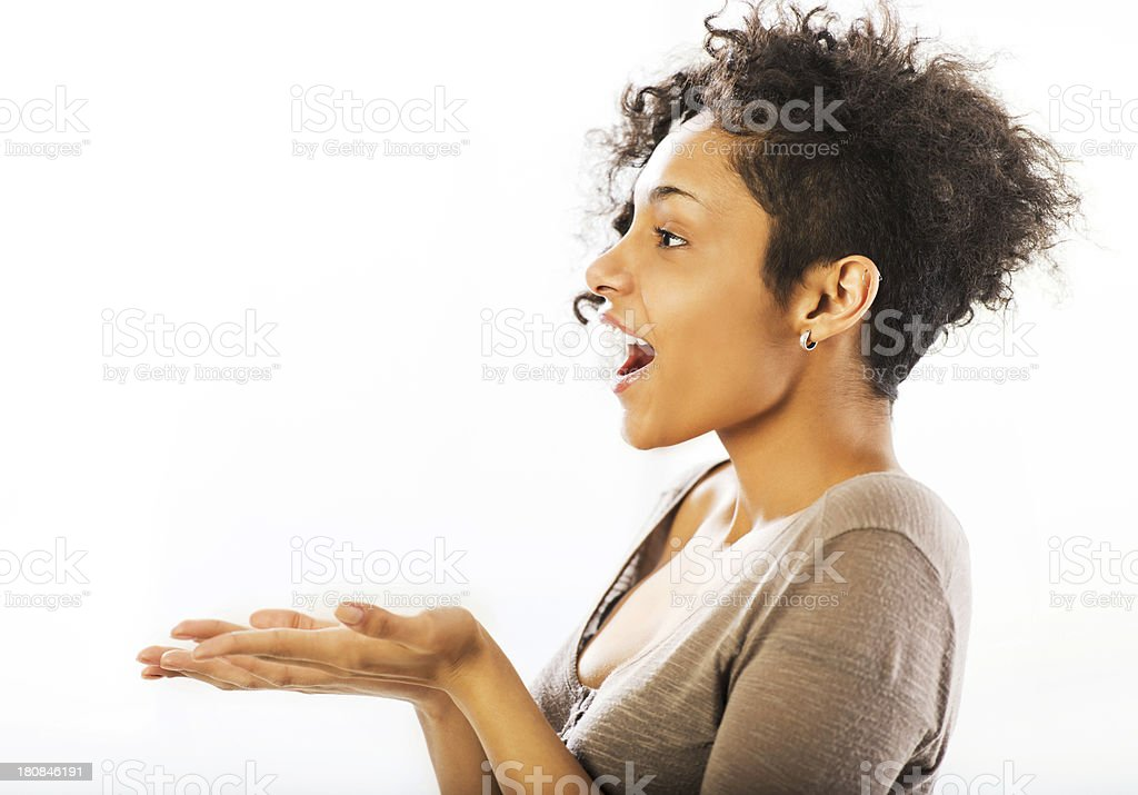 Woman presenting a product. stock photo