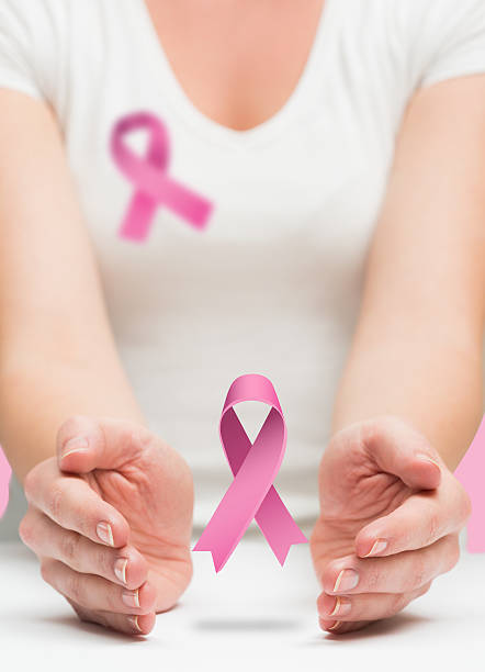 Woman presenting breast cancer awareness message stock photo
